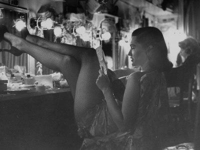 Chorus Girl-Singer Linda Lombard, Resting Her Legs after a Tough Night on Stage