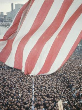 Giant American Flag Flying over a Large Crowd During President Johnson's Asia Tour by George Silk