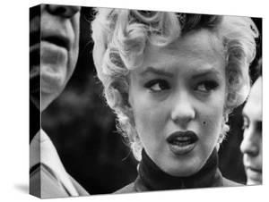 Marilyn Monroe Face Reporters After Announcement Divorce From Baseball Great Joe DiMaggio by George Silk