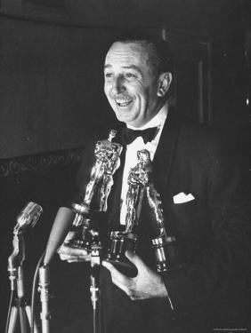 Movie Producer Walt Disney Holding Four Oscar Awards He Won by George Silk