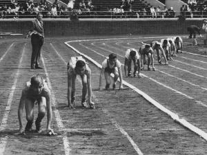 Penn Relay Races, College Students Crouched in Starting Position by George Silk