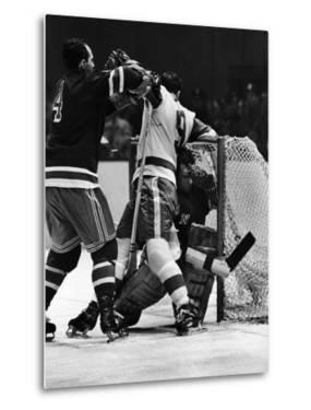 Ranger Goalie Jack McCarran and Detroit Red Wings Gordie Howie During Game by George Silk