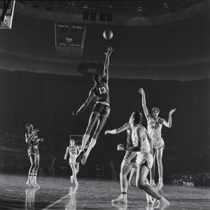 University of Kansas Basketball Player Wilt Chamberlain (C) Playing in a School Game, 1957 by George Silk