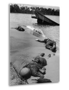 Bodies of Dead American Soldiers Near Half Sunken Landing Craft on Buna Beach by George Strock