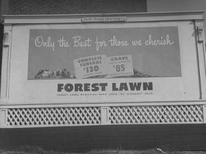 Close Up of Sign Advertising Forest Lawn Cemetery by George Strock