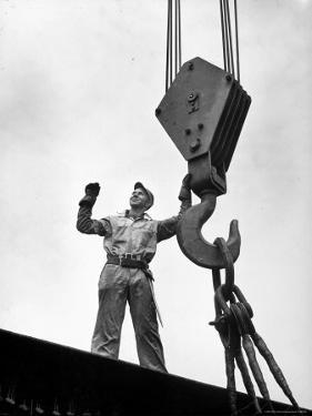 Man Working as a Rigger During Building of a Ship by George Strock