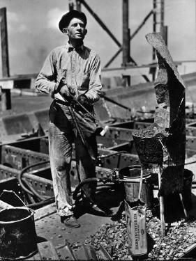 Man Working in the Shipbuilding Industry by George Strock