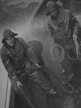 Naval Officers Working on a Ship During a Storm by George Strock