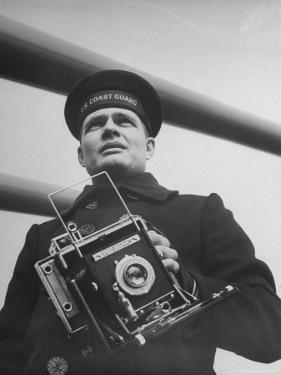 Navy Soldier Holding Camera by George Strock