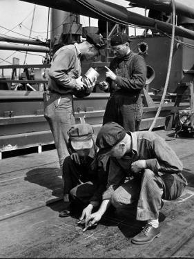 Pipefitters and Welders Discussing Installation During Shipbuilding Process by George Strock