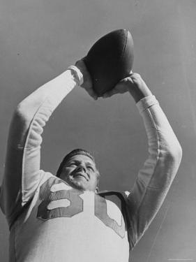 University of Texas Football Player Malcolm Kutner Holding the Ball by George Strock