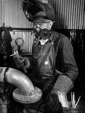 Welder Working in the Shipbuilding Industry by George Strock