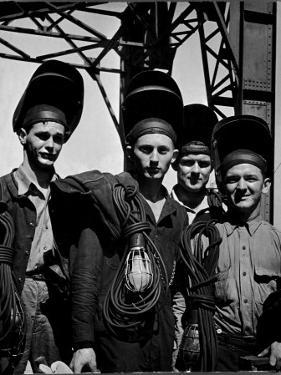 Welders Arriving to Work Night Shift at Shipbuilding Yard; Roosevelt's Decree of a 7 Day Work Week by George Strock