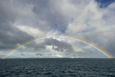 Antarctica, full rainbow, Gerlach Strait by George Theodore