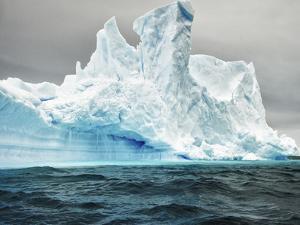 Antarctica, large iceberg, blue ice by George Theodore