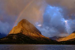 USA, Montana. Glacier National Park, Grinnell Mountain, sunrise, rainbow by George Theodore