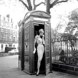 Lucinda in a Telephone Box, London, 1959 by Georges Dambier
