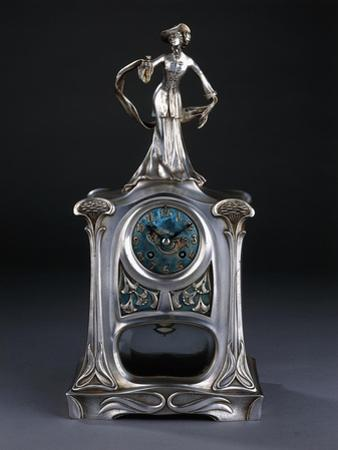 A Mantel Clock Surmounted by a Figure of an Elegant Lady by Georges de Feure