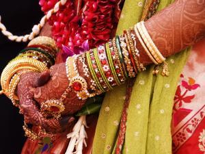 Bejewelled Bride with Henna Hands at Mumbai Wedding by Gerard Walker
