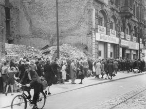 East Berliners Queueing in Front of a Currency Exchange Point in Invalidenstrasse, Berlin-Mitte,… by German photographer