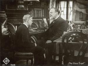 """Still from the Film """"The Blue Angel"""" with Emil Jannings and Rolf Mueller, 1930 by German photographer"""