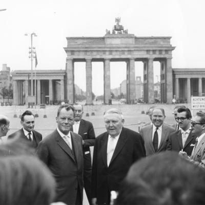 Ludwig Erhard and Willy Brandt, Mayor of West Berlin, Inspect the Sector Border at Brandenburg…