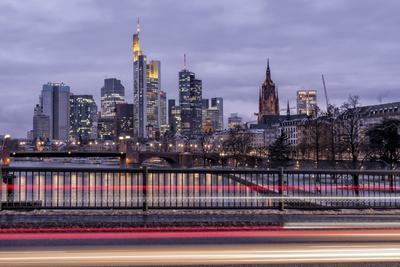 https://imgc.allpostersimages.com/img/posters/germany-hesse-frankfurt-on-the-main-skyline-at-dusk-light-tracks-of-passing-cars_u-L-Q11YVD70.jpg?p=0
