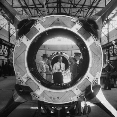 Germaqn Scientist Wernher Von Braun Examining a Jet Engine