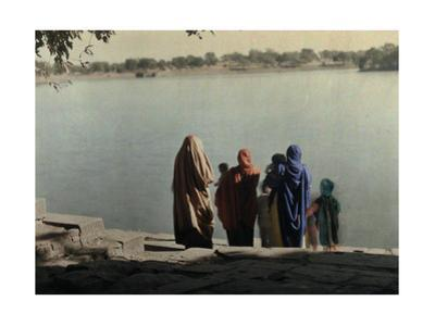 A Family Stands on the Stone Shoreline of the Sacred Lake, Pushkar by Gervais Courtellemont