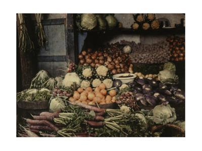 A Food Vendor's Fruit and Vegetable Stand at a Market by Gervais Courtellemont