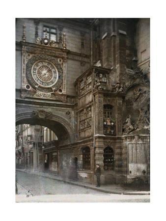 A Man Stands at a Corner Beneath an Arch Bearing an Elaborate Clock by Gervais Courtellemont