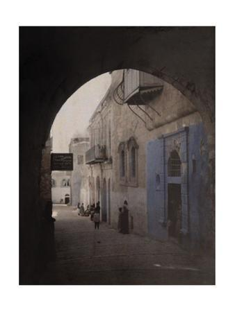 A View Through an Archway of a Street in the Jewish Quarter by Gervais Courtellemont