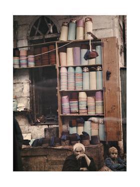 An Egyptian Street Merchant Sells Hats by Gervais Courtellemont