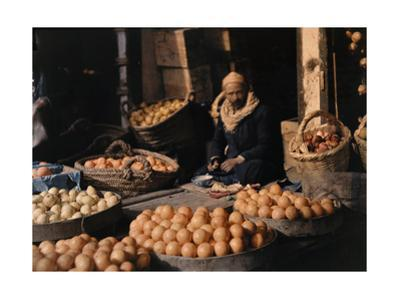 An Orange Merchant Sits with His Wares by Gervais Courtellemont