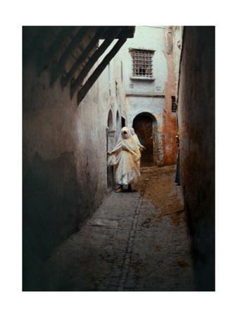 Two Moorish Women Walk in an Alleyway by Gervais Courtellemont