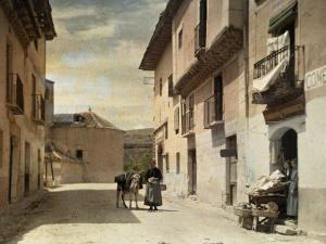 Woman and Donkey Stand in an Empty Street in Segovia by Gervais Courtellemont