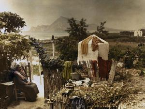 Woman Sits in Her Garden in Altea by Gervais Courtellemont