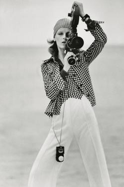 Vogue - April 1972 - Woman with a Film Camera by Gianni Penati