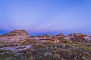 Gibbous Moon and Crepuscular Rays over Dinosaur Provincial Park, Canada