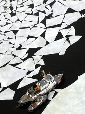 Gigantic Shards of Ice Drift Near a Pair of Coast Guard Cutters