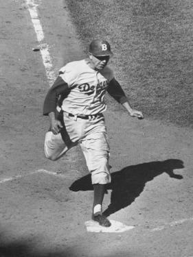 Gil Hodges Wearing Baseball Cap Running to Base During World Series Game