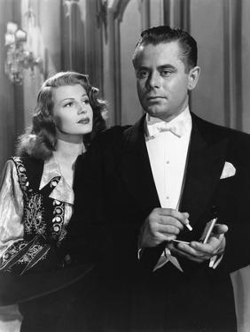GILDA, 1946 directed by CHARLES VIDOR Rita Hayworth and Glenn Ford (b/w photo)