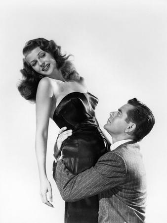 https://imgc.allpostersimages.com/img/posters/gilda-1946-directed-by-charles-vidor-rita-hayworth-and-glenn-ford-b-w-photo_u-L-Q1C3Z400.jpg?artPerspective=n