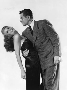 GILDA, 1946 directed by CHARLES VIDOR Rita Hayworth and Glenn Ford (b/w photo)