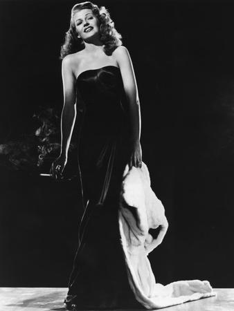 https://imgc.allpostersimages.com/img/posters/gilda-1946-directed-by-charles-vidor-rita-hayworth-b-w-photo_u-L-Q1C3TMG0.jpg?artPerspective=n