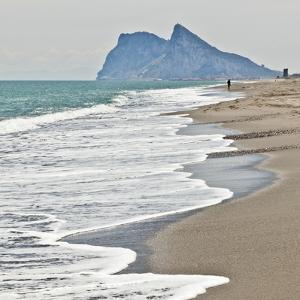 Tourist Walking Toward Gibraltar, Alcaidesa Beach, Near Sotogrande, Andalucia, Spain, Europe by Giles Bracher