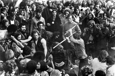 https://imgc.allpostersimages.com/img/posters/gimme-shelter-hell-s-angels-beating-an-audience-member-at-altamont-1970_u-L-Q1BUC8E0.jpg?artPerspective=n