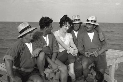 https://imgc.allpostersimages.com/img/posters/gina-lollobrigida-on-the-seashore-with-lifeguards_u-L-Q10QJ270.jpg?p=0