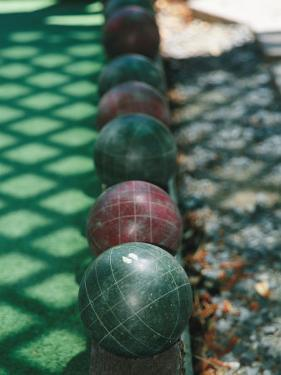 Wooden Balls That are Bowled in the Italian Game of Bocce by Gina Martin