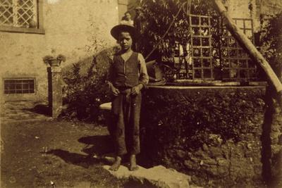 Child in Front of Well, Photograph Taken
